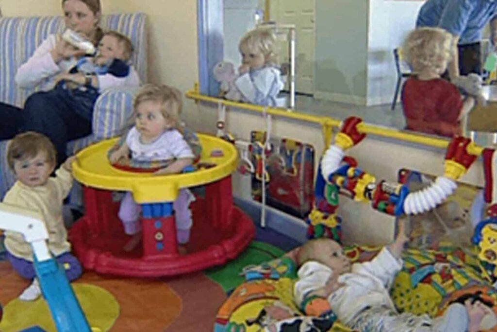 Teacher caring for babies in early childhood centre