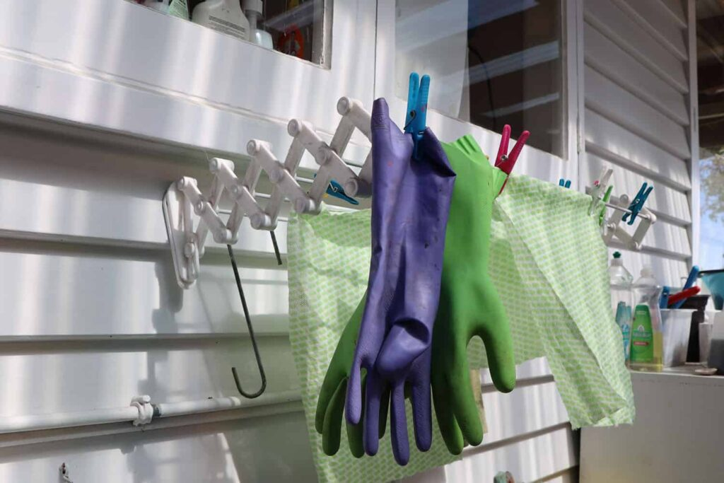 cleaning gloves and clothes hanging to dry