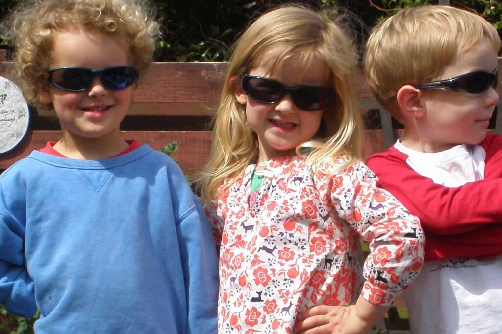 Three cool kids showing their early childhood confidence.