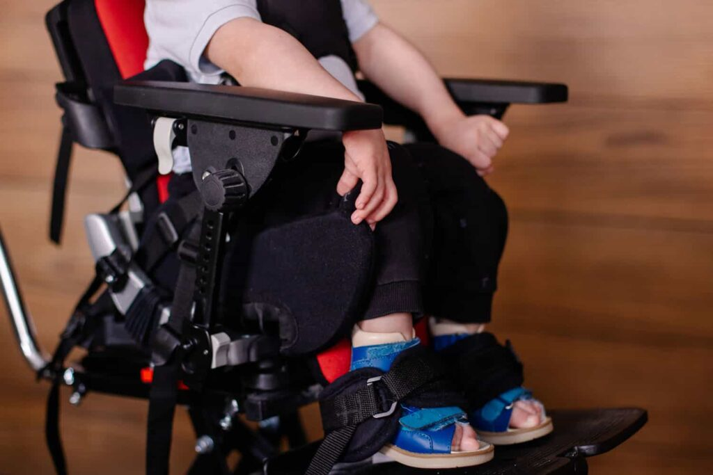 Children with disabilities in early childhood education services with wheelchair.