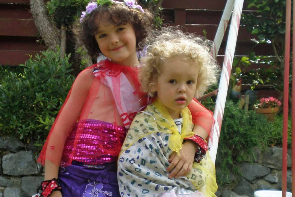 children playing with dress-ups/ costumes in home-based ECE