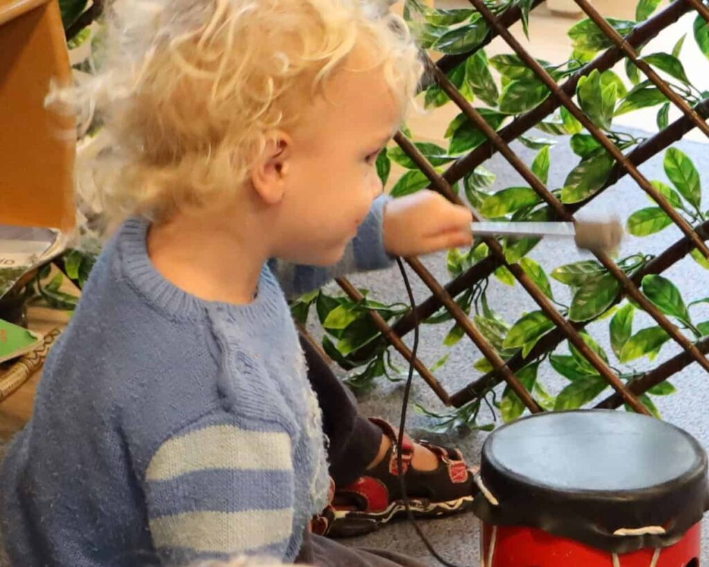 Daycare toddler is banging a drum - listen to me!