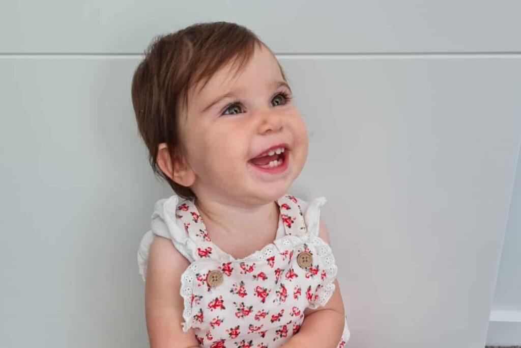 Happy toddler showing pleasure.