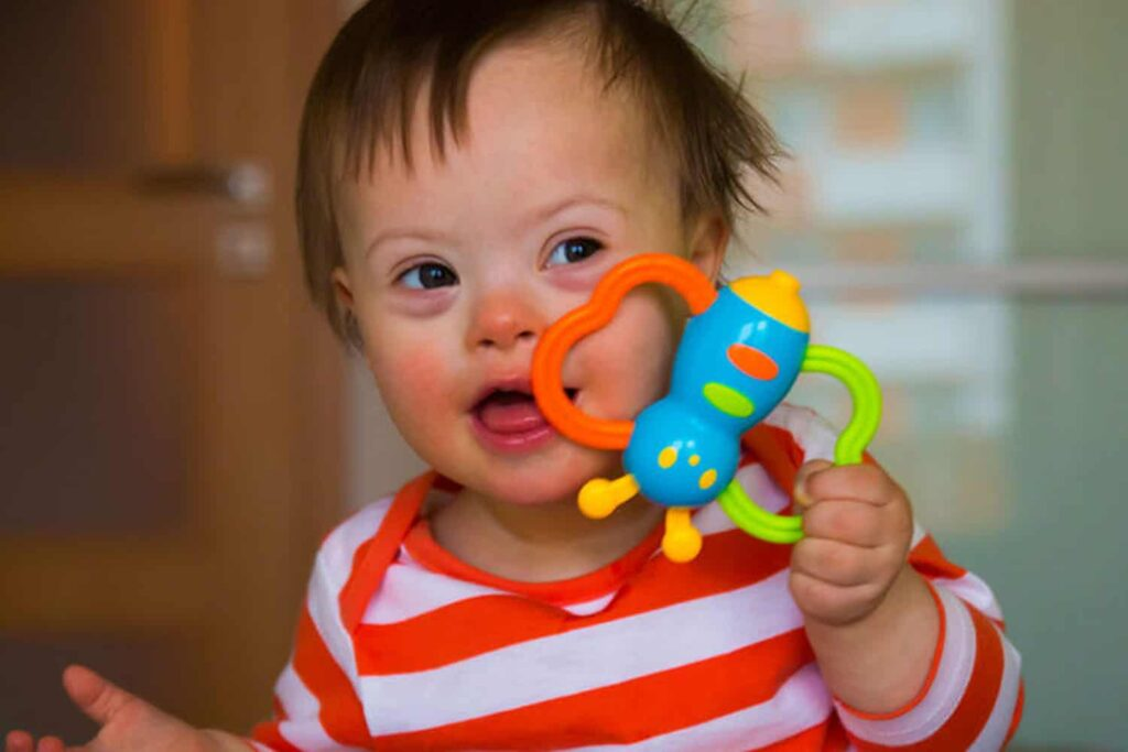 caring and teaching children with additional needs - image of down syndrome child