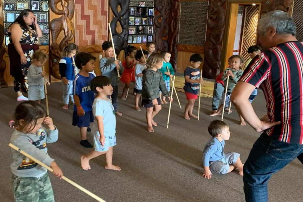 Children supported in their Maori cultural development - learning a haka.