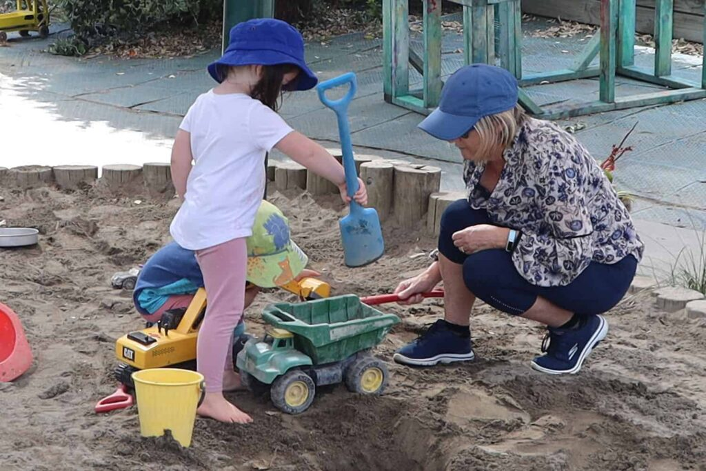 sandpit play in summer