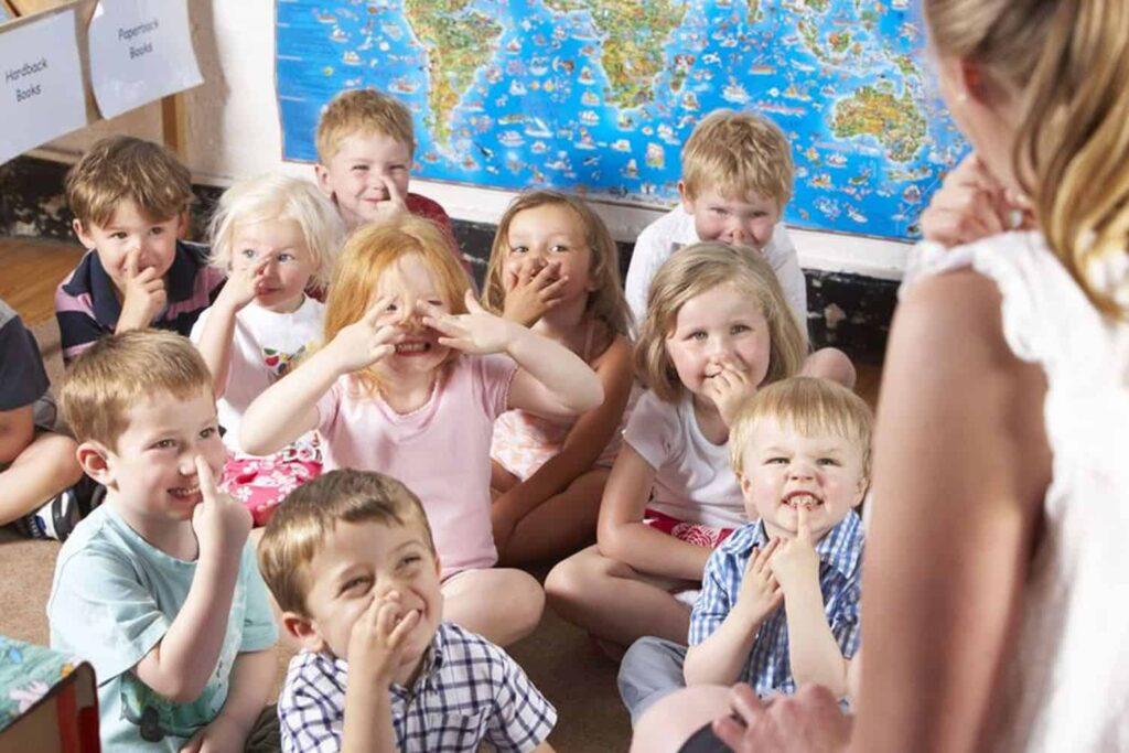 school group mat teacher directed montessori