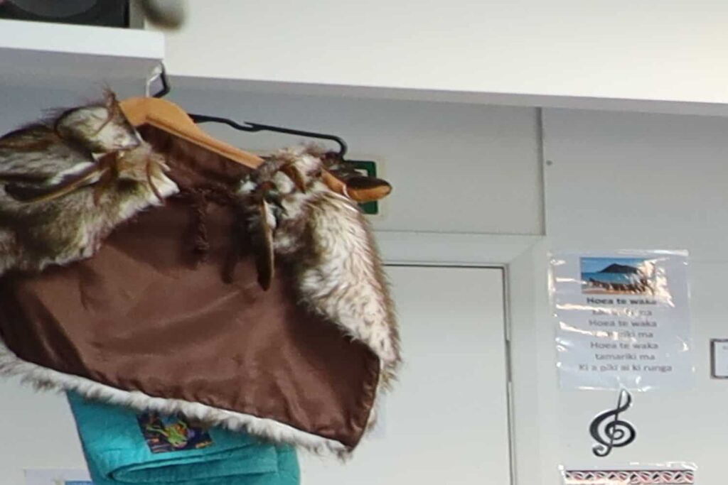 Child's Maori cape hanging at preschool