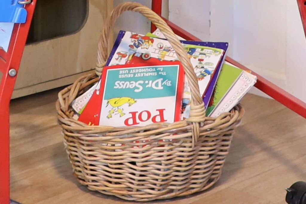 A basket of children's books for children to carry to any place they want at their early childhood centre