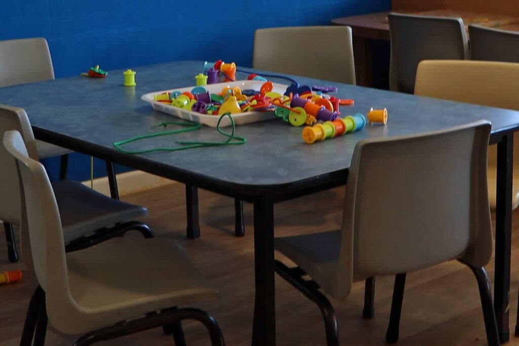 preschool table with threading activity to promote child hand-eye co-ordination