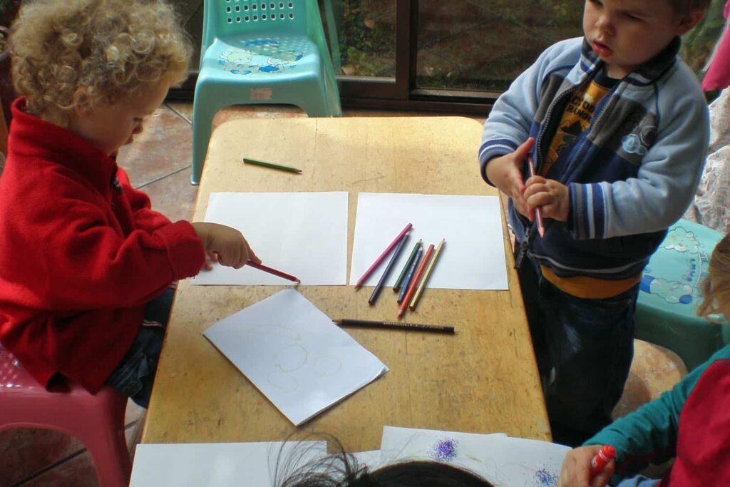 children writing drawing homebased